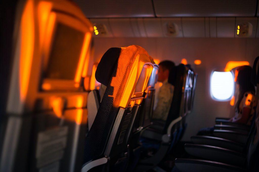 People sleeping on a plane.