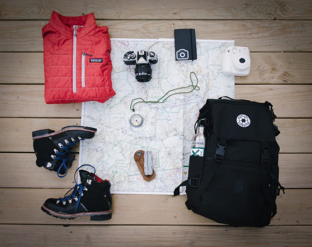 Some travel gear layed out on a map.