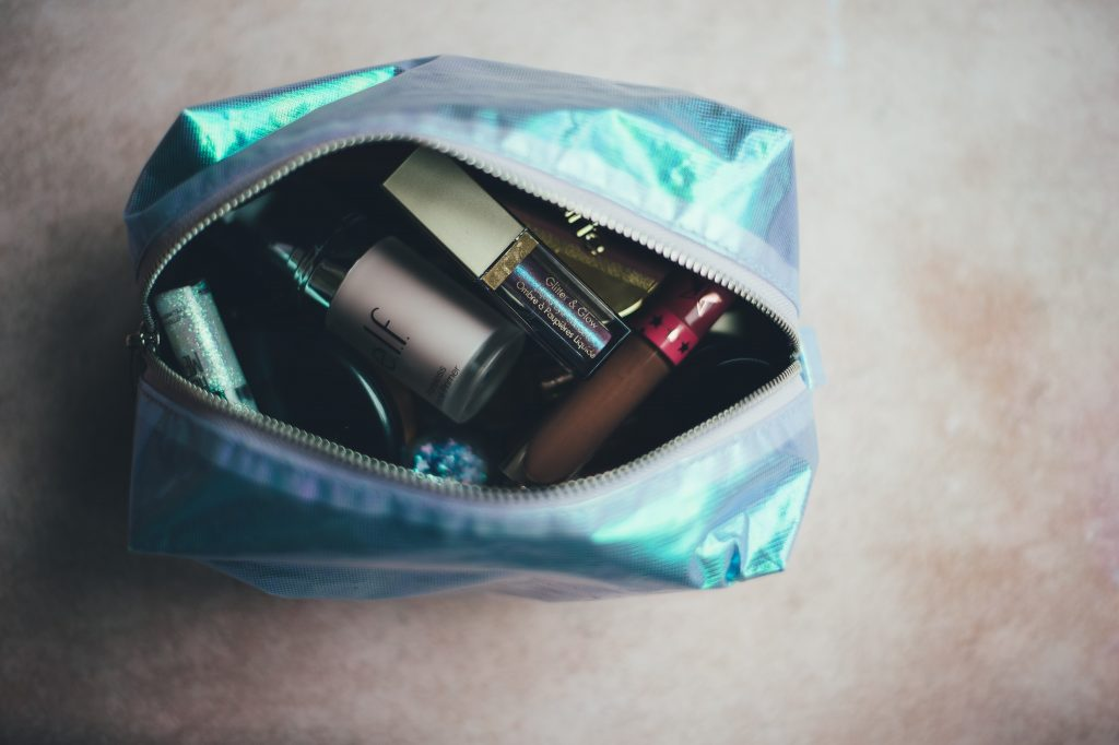 Makeup bag, an example of travel accessories for women.