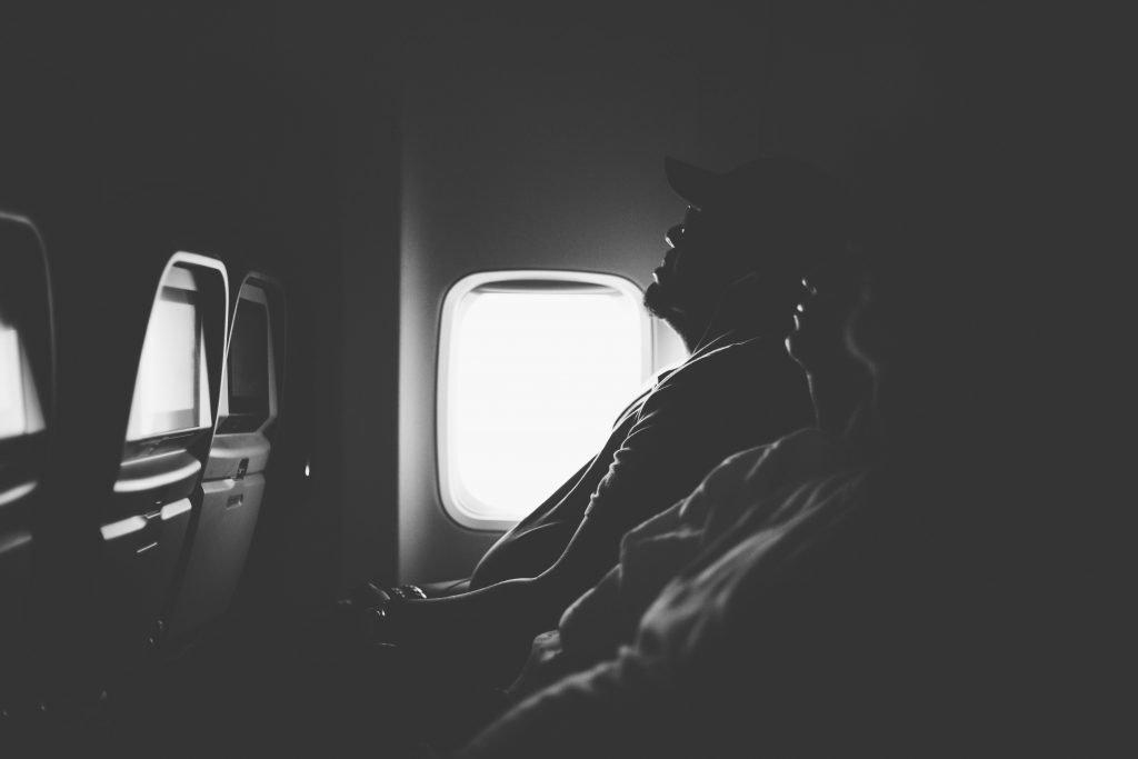 Passengers sleeping on a plane.