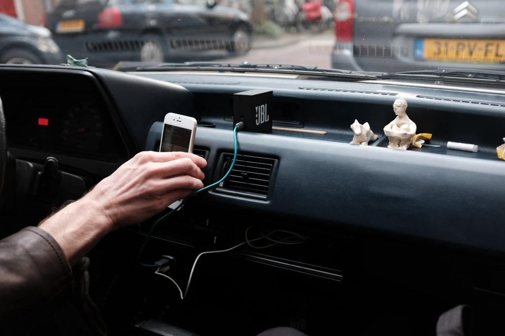 Driver making use of Travel Accessories For Cars.